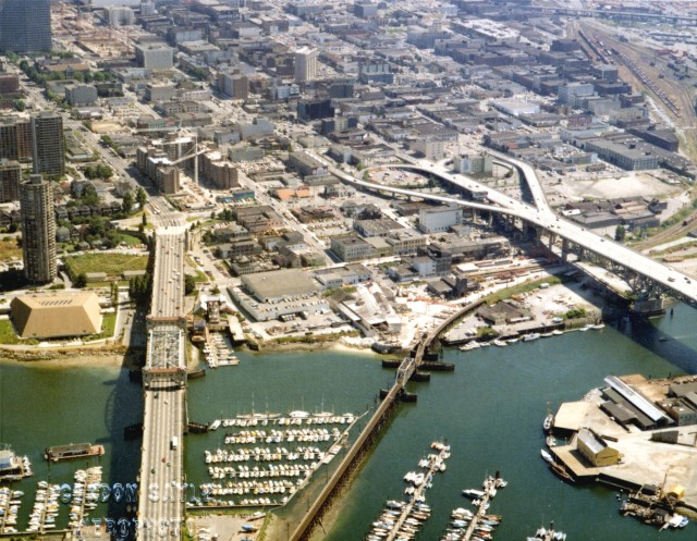 1970s-Aerial-view-of-Downtown-Vancouver-and-False-Creek-between-Burrard-Street-and-Granville-Street-Bridge-with-train-bridge-and-Granvill