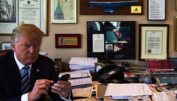 Donald Trump demonstrates his tweeting skills in his office at Trump Tower in New York.