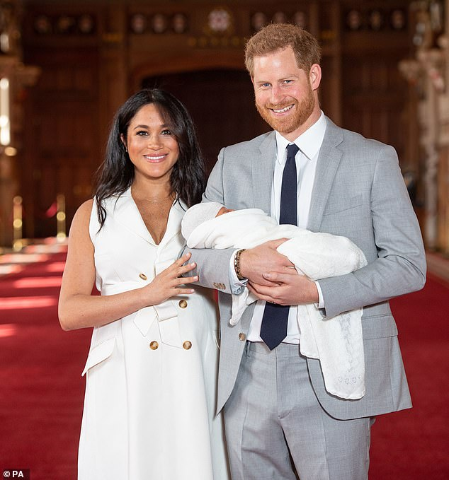 13241006-7005497-The_Duke_and_Duchess_of_Sussex_are_pictured_with_their_baby_son_-a-54_1557317688438