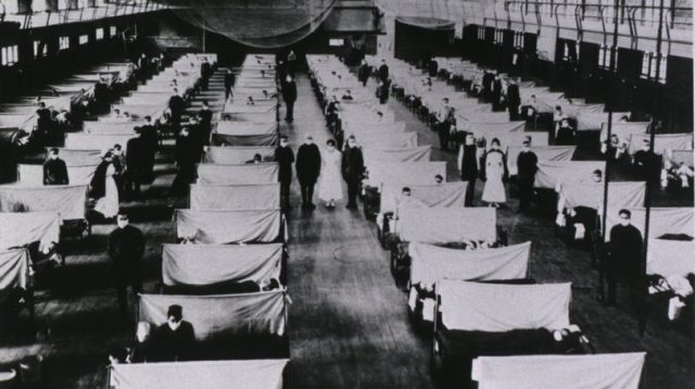 Spanish Flu Epidemic 1918-19. U.S. school gymnasium converted into an flu ward with patients' beds a